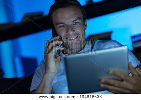 Did you see that article. Savvy inspired clever man holding his tablet and looking at the article he wanting talking about with his colleague