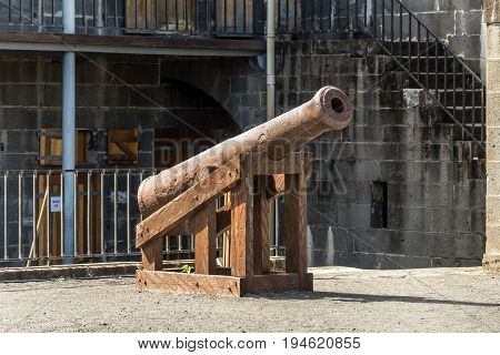Port Louis Mauritius - December 25 2015: Old cannon in the courtyard of the Fort Adelaide in Port Louis Mauritius.