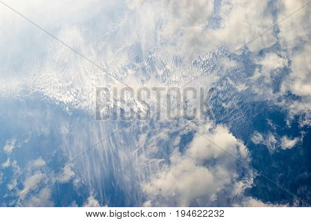 Sky with unusual pattern of spindrift clouds
