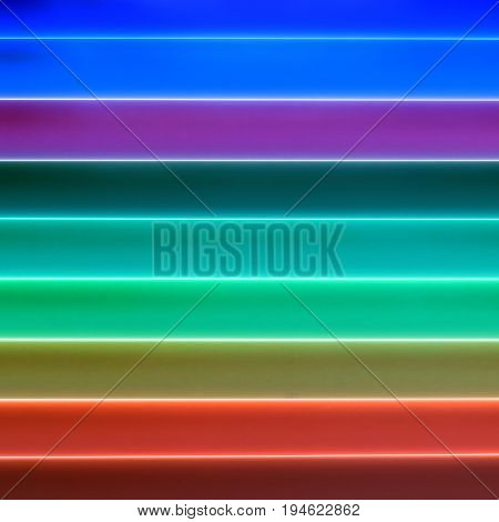 Colorful shinning cylinders arranged in a row