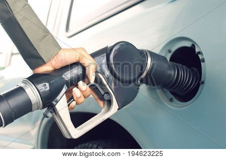 Woman pumping gas, close up of hand