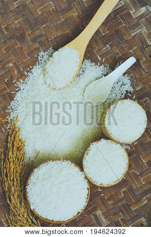 jasmine rice Rice in Wooden Bowl basmati rice rice is on wooden floor as background.