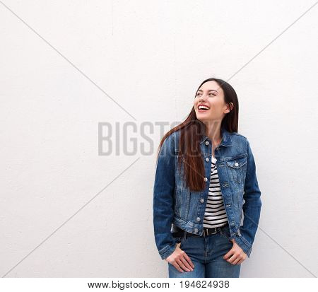 Laughing Woman Standing In Denim Jacket