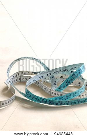 Measuring tape on table, elevated view