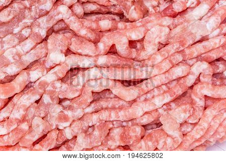 Detail of fresh and raw minced pork from supermarket fresh food ingredients concept.