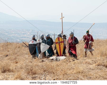 Tiberias Israel July 01 2017 : Participants in the reconstruction of Horns of Hattin battle in 1187 Dressed in the costumes of crusaders stand in anticipation of an attack near Tiberias Israel