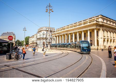 BORDEAUX, FRANCE - May 26, 2017: View on the crowded Comedy square crowded with modern tram and famous Grand Theatre building in Bordeaux city during the sunny day in France