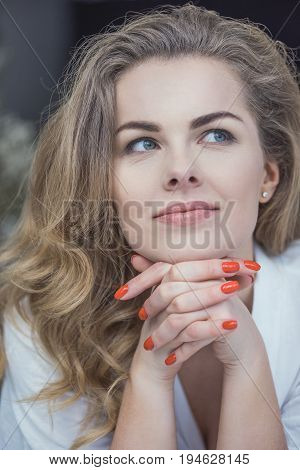 Portrait Of Beautiful Blonde Dreamy Woman With Red Manicure