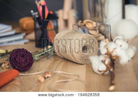 Florist Workplace With Dry Cotton Flowers, Twine And Different Supplies