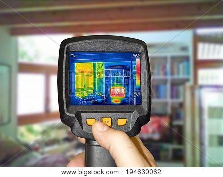 Recording heated TV and a window in the living room with thermal camera