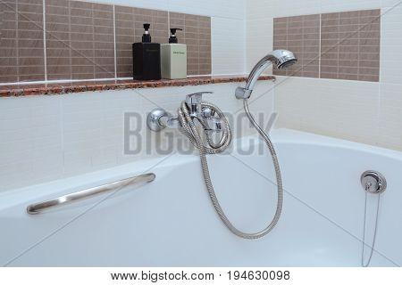 Beautiful Bathroom bidet faucet closeup as background