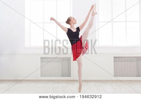 Classical Ballet, ballerina on pointe. Beautiful graceful dancer practice ballet positions. Training, performance, copy space
