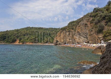 The sand and pebble beach of Mogren in Budva one of the most popular beaches on the Budva Riviera