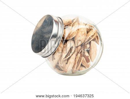 Wild uzbek almonds in a jar isolated on white background
