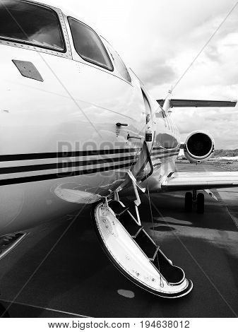 Private jet sitting on the tarmac with its door open