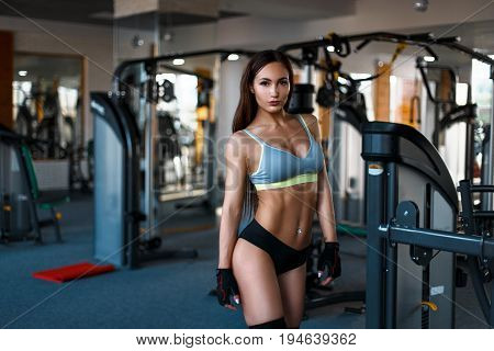 Beautiful Young Woman With A Sexy Body In A Sports Bra And Black Panties Trains In The Gym