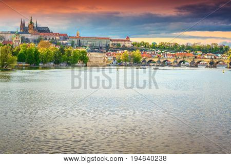 Magical sunset and spectacular cityscape with old stone Charles bridge castle and Saint Vitus Cathedral in Prague Czech Republik Europe