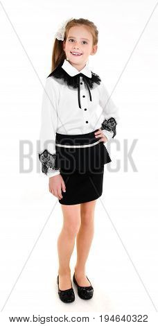 Portrait of smiling happy school girl child in uniform isolated on a white background