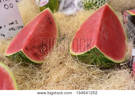 Selling watermelons in a banquet of the local market