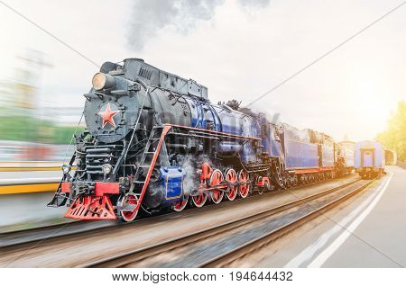 Vintage Black Steam Locomotive Train Rush Railway Station. Concept Of Tourism Is A Retro Journey By