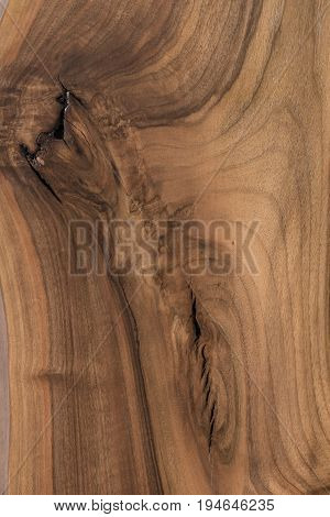 Close-up of wooden plank with expressive uneven pattern and fissure on it. Timber background with copy space