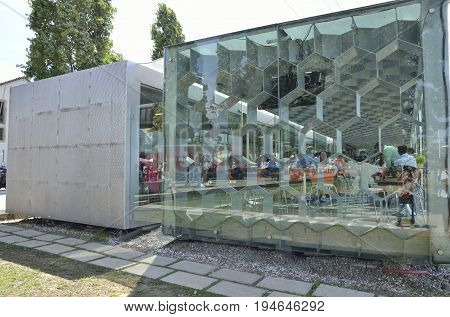 GAIA, PORTUGAL - AUGUST 7, 2015: Exterior of crystal and steel facade of modern restaurant in Gaia Portugal.