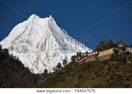 Himalayan buddhist monastery in front of Manaslu Peak (8156 m) - the eighth highest mountain in the world.