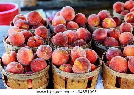 Peaches on a weekly street market stall Selling peaches on the market