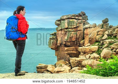 Attractive young sportive hiker woman in nature Perros Guirec Brittany region France Europe