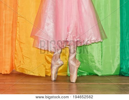 Slender Legs Of A Ballerina Clad In Pointe Shoes, Standing On Toes