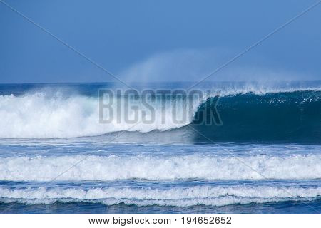 Wave breaking in the sea with foam on top