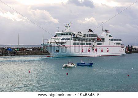 Playa Blanca, Spain - December 13, 2014: The ferry Volcan de Tindaya ARMAS in harbour in Playa Blanca Lanzarote Canary Islands Spain. It connects 6 times daily Lanzarote with Fuerteventura.