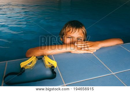 Boy in swimming pool at swimming lessons