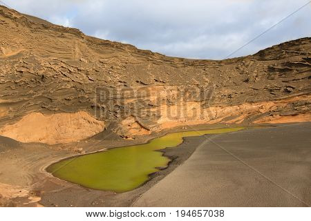 Green volcanic lake in lanzarote, canary islands, spain