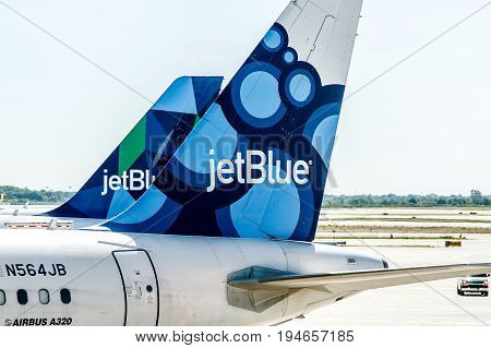 New York June 22 2017: Two JetBlue airplanes are parked by the gates awaiting passenger boarding.