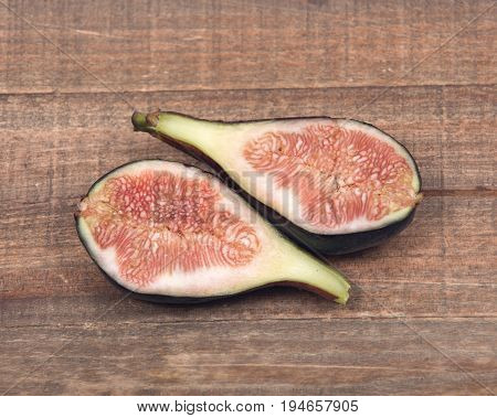Fresh ripe organic figs on vintage wooden tray