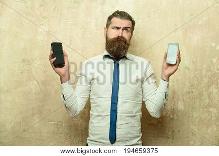 Hipster Or Bearded Man Compare Mobile Phone And Smartphone