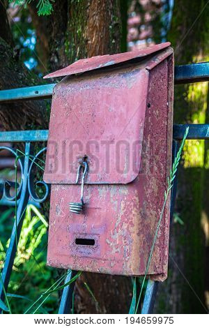 Old rusty mailbox with a broken lock