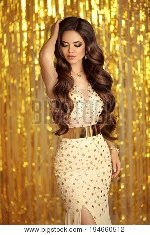 Elegant Brunette In Golden Sparkling Dress. Fashion Glamour Style. Beautiful Stunning Woman With Lon