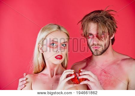 Young Couple Of Woman And Man With Makeup Hold Pomegranate