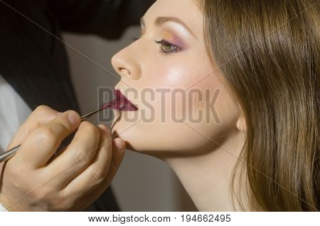 Visagiste Putting Lipstick With Brush