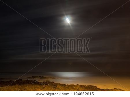 Long Time Exposure At Night Of The Moon Over The Wild Coast At The Indian Ocean In South Africa