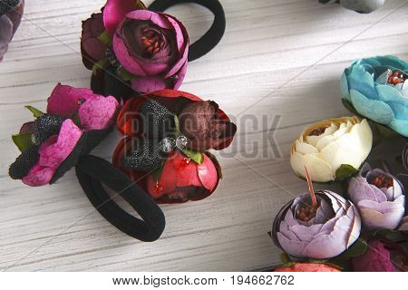 Variety of hair rubbers decorated with flowers. Beautiful handmade scrunchies assortment, female decoration, beauty concept