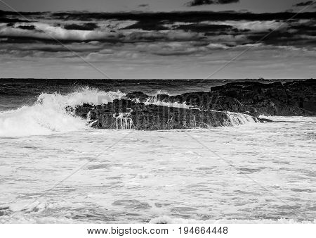 Black And White Image Showing Rolling Waves At The Wild Coast Of The Indian Ocean At South Africa