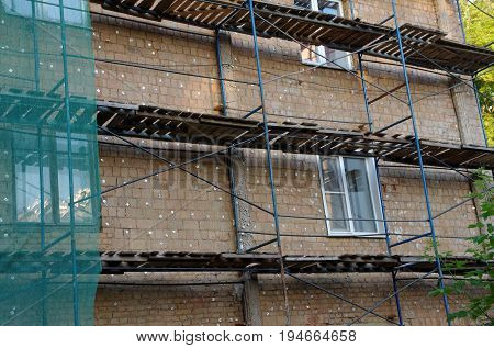 Scaffolding covering a facade of an old building.