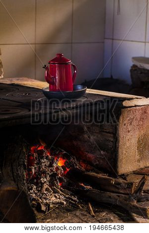 Making Coffee Over A Rustic Oven