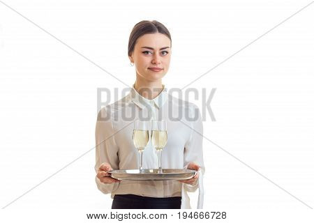 cute young waitress in uniform with trey isolated on white background