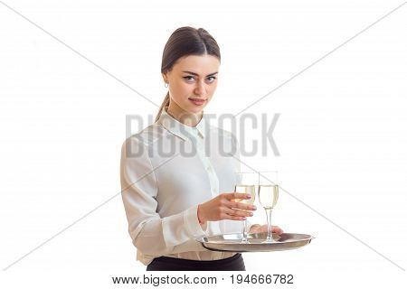 pretty young waitress in uniform with trey isolated on white background