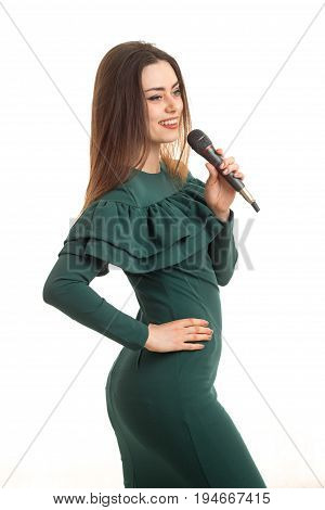 lovely young woman in green dress singing song with karaoke isolated on white background