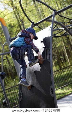 Child Climbing In Playground